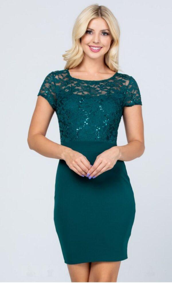 Model wears hunter green short dress