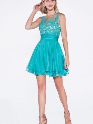 Model wears turquoise shot dress