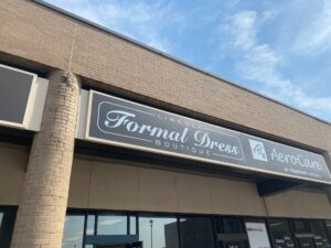 the outside sign of Lincoln Formal Dress Boutique